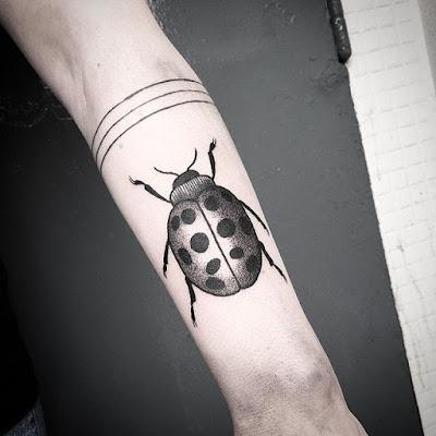 arm ladybug tattoo