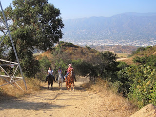 Horseback riders approaching Vista Del Valle Drive, Griffith Park