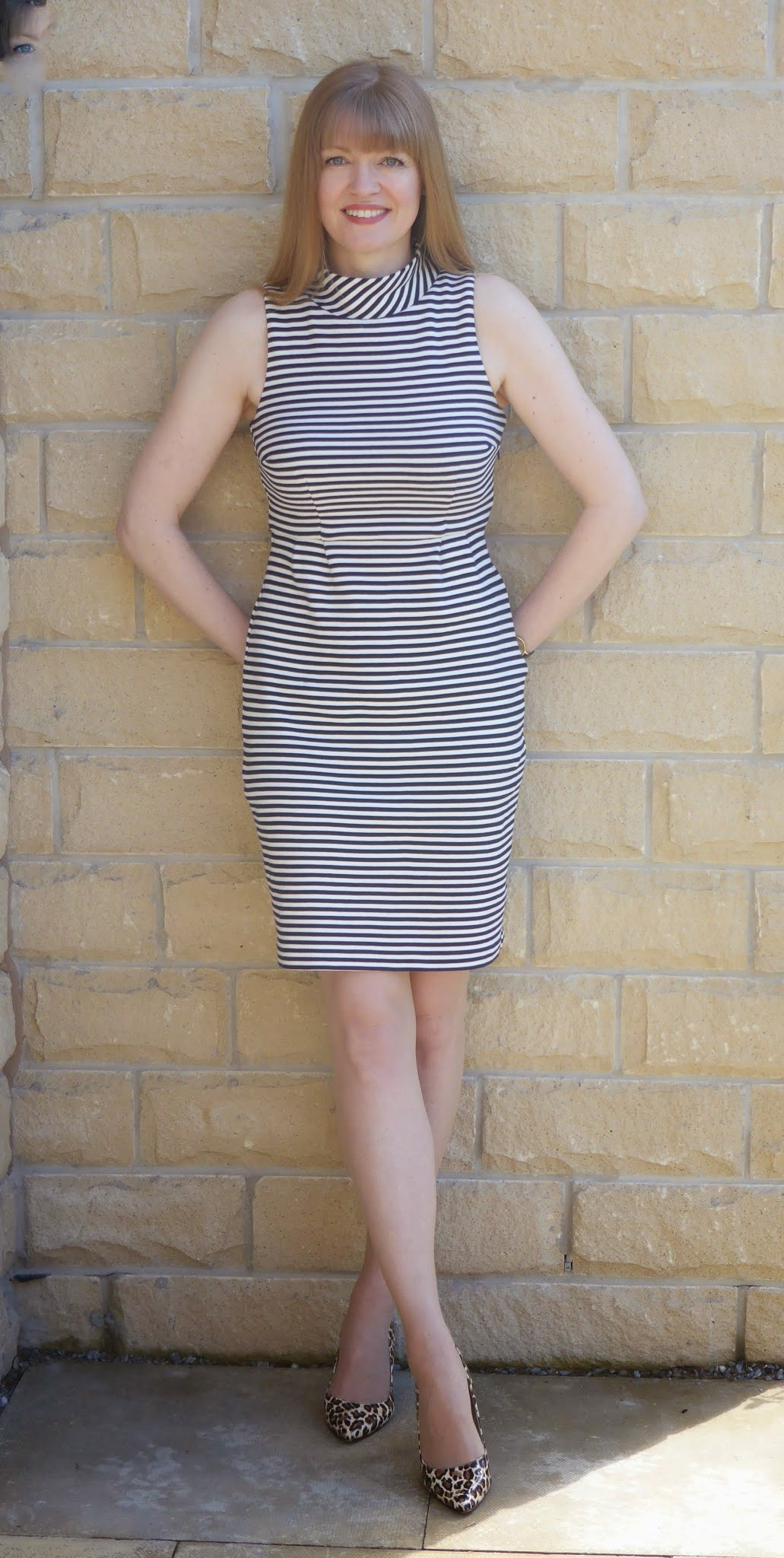 What Lizzy Loves, over 40 fashion blogger wears fitted navy and white striped Boden sixties style dress with leopard heels. Leopard shoes