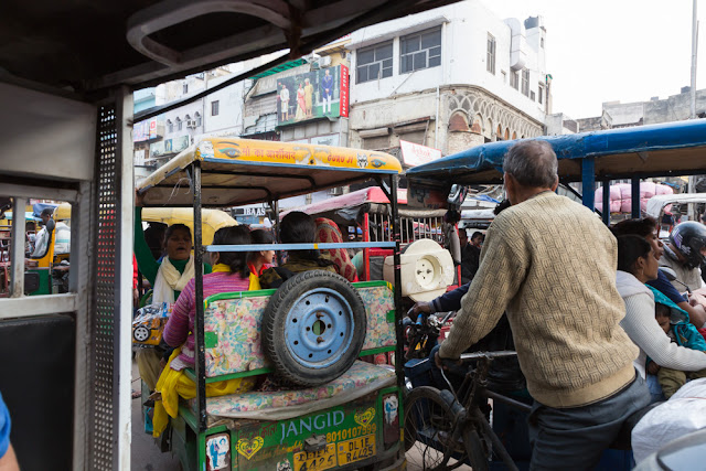 auto rickshaw ride in traffic in old delhi india people