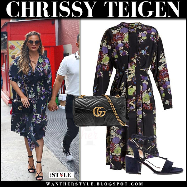 Chrissy Teigen in black floral print wrap dress isabel marant with black Gucci bag what she wore july 28 2017