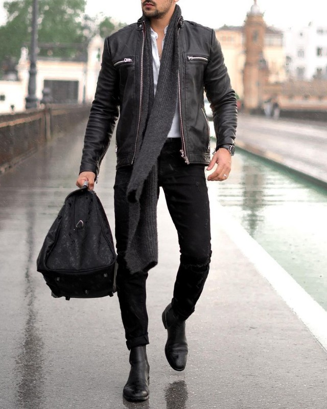 A man wearing Leather jackets+shirts+jeans + Chelsea boots+woolen muffler combinations outfit.