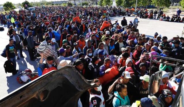 Caravan migrants scaling U.S. border fence