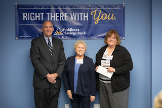 Michael McAuliffe, CEO of Middlesex Savings Bank, with Friends of Franklin Library board members Kathie Nosek (center) and Maria Lucier (right)