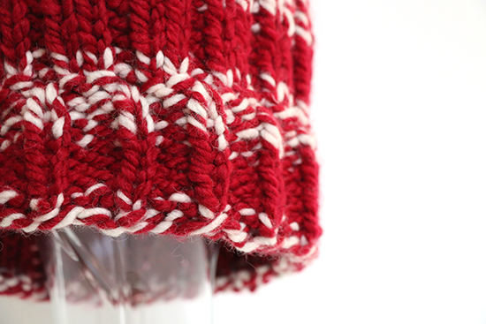 Detail on Crimson and White Knit Hat