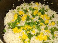 Saffron soaked milk over rice in pressure cooker for veg biryani recipe