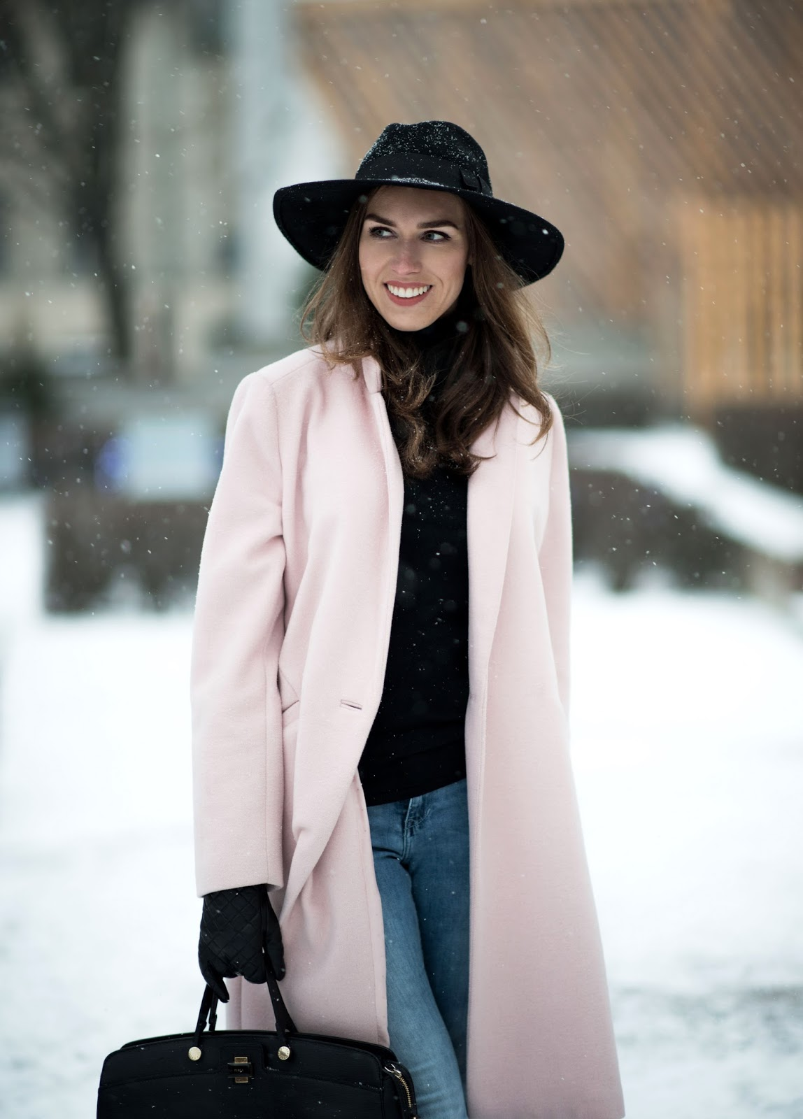 pink coat black fedora hat