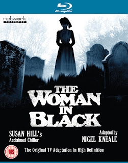 Blu-ray cover featuring Woman in Black ghost silhouetted in graveyard
