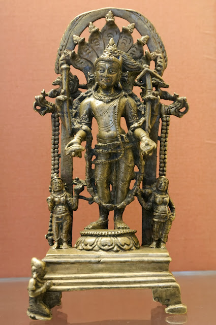 Standing figure of Balarama with the club, plough, conch and wine cup. Gold and brass, 9th century AD.