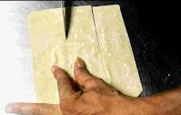 Cutting and making samosa patti with a knife