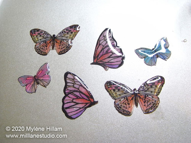 Resined butterfly paper cutouts