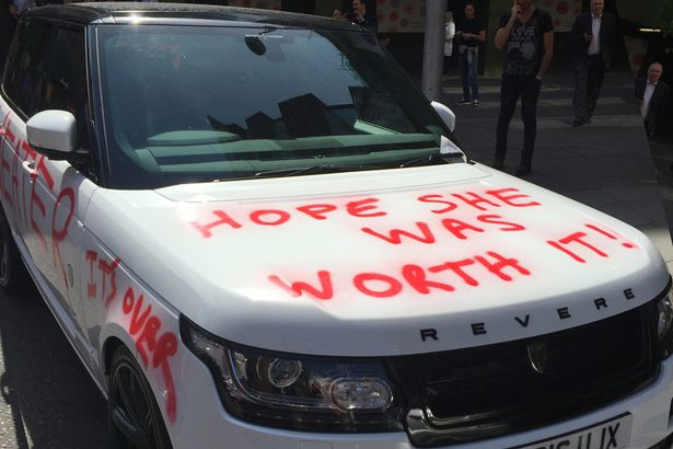 red paint all over cheaters range rover parked outside harrods