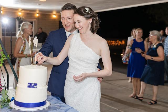 wedding cake cut at a backyard AZ wedding in july