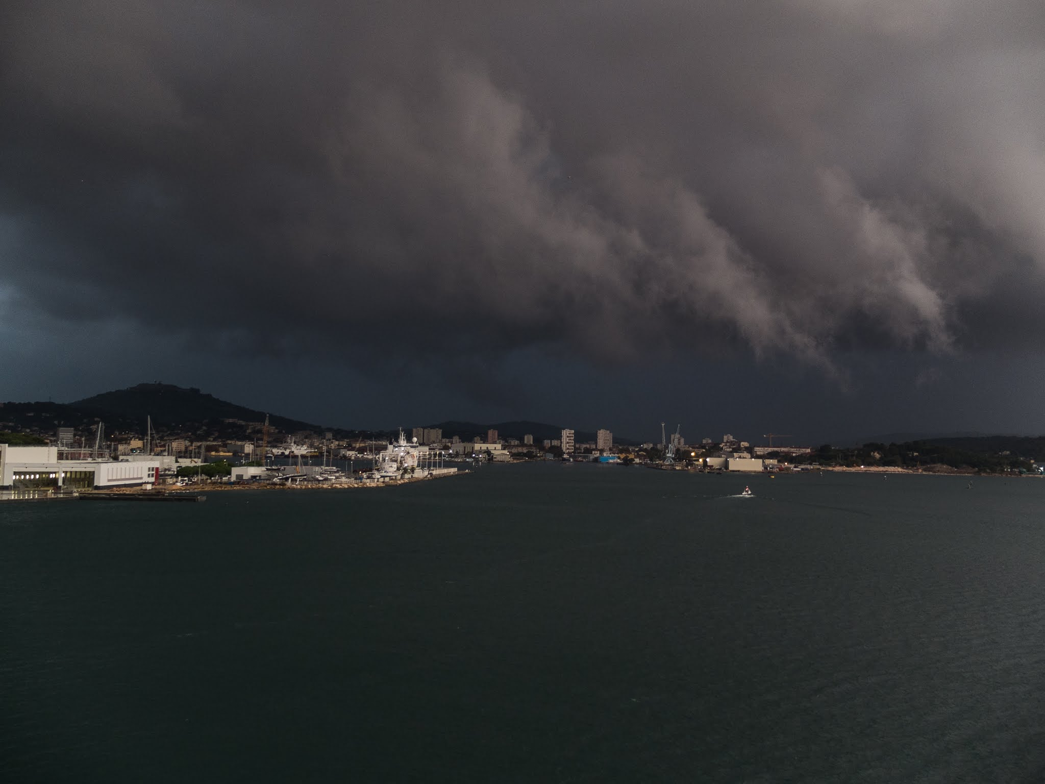 Sunlight reflecting off of clouds in the port of Toulon, Southern France.