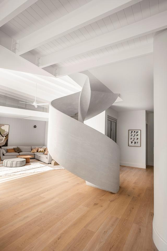 Dramatic lime wash spiral staircase