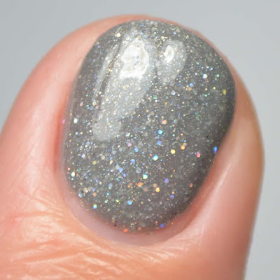 grey nail polish with holographic glitter close up swatch