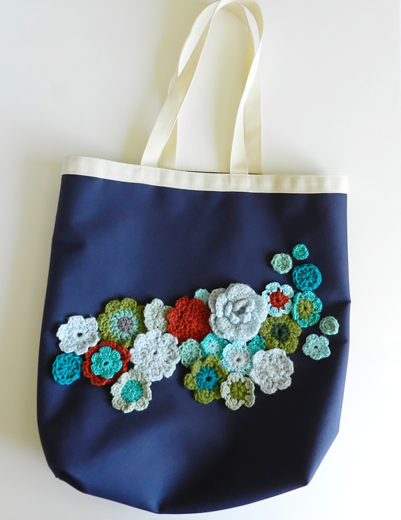 upcycled canvas bag of crochet flowers