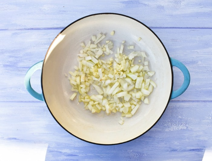 Step 1 - sliced onions in a shallow casserole pan
