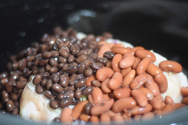 Add the beans to the slow cooker.