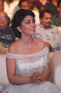 Shriya Saran in Stunning White Off Shoulder Gown at Nakshatram music launch ~  Exclusive