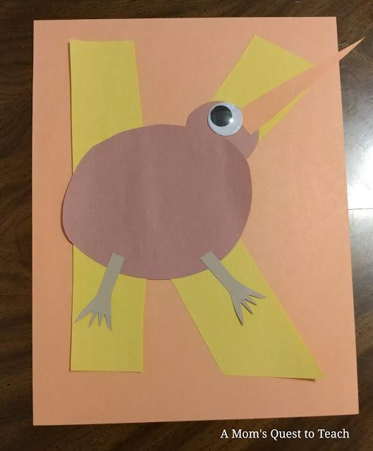 Construction paper kiwi glued onto letter K