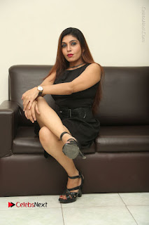 Tollywood Upcoming Actress Pooja Roshan Stills in Black Short Dress at Plus 1 Movie Trailer Launch  0292.JPG