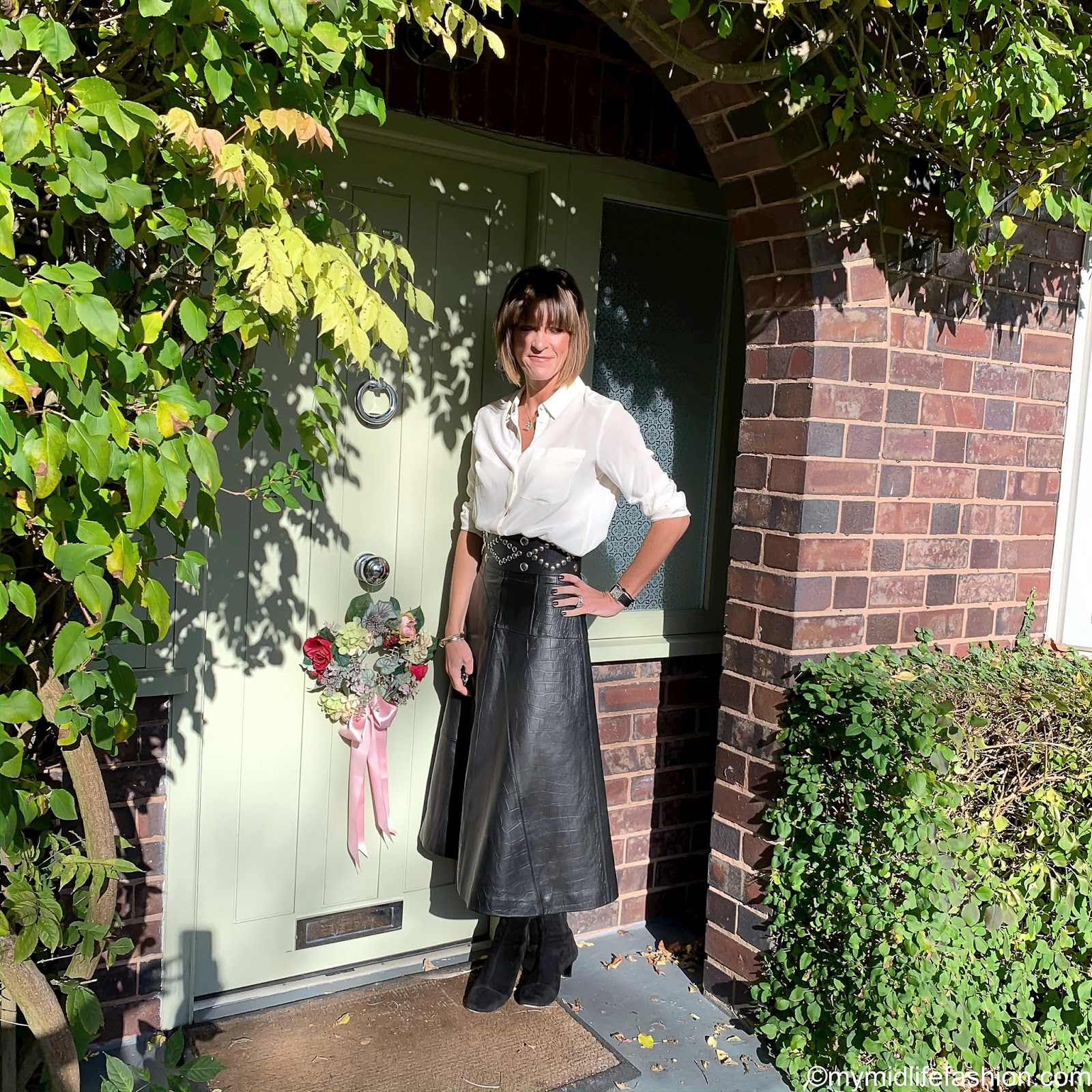 my midlife fashion, marks and Spencer leather fit and flare midi skirt, marks and Spencer pure silk long sleeve shirt, Isabel Marant studded belt, Isabel Marant suede ankle boots