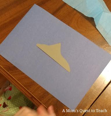 shark fin glued onto blue construction paper