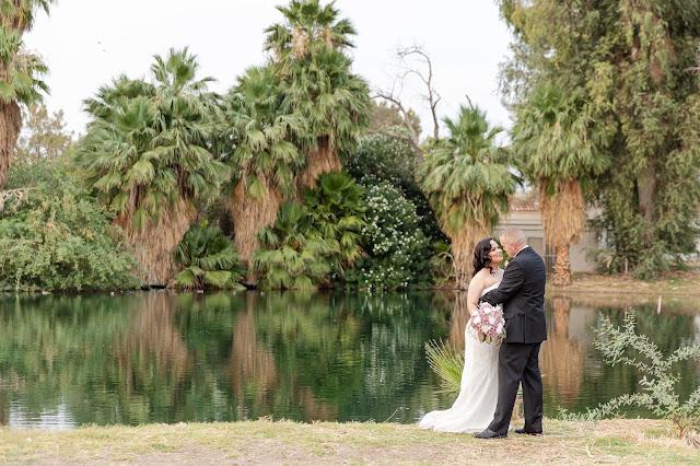 bride and groom wedding portraits near the lake at az golf resort in mesa az