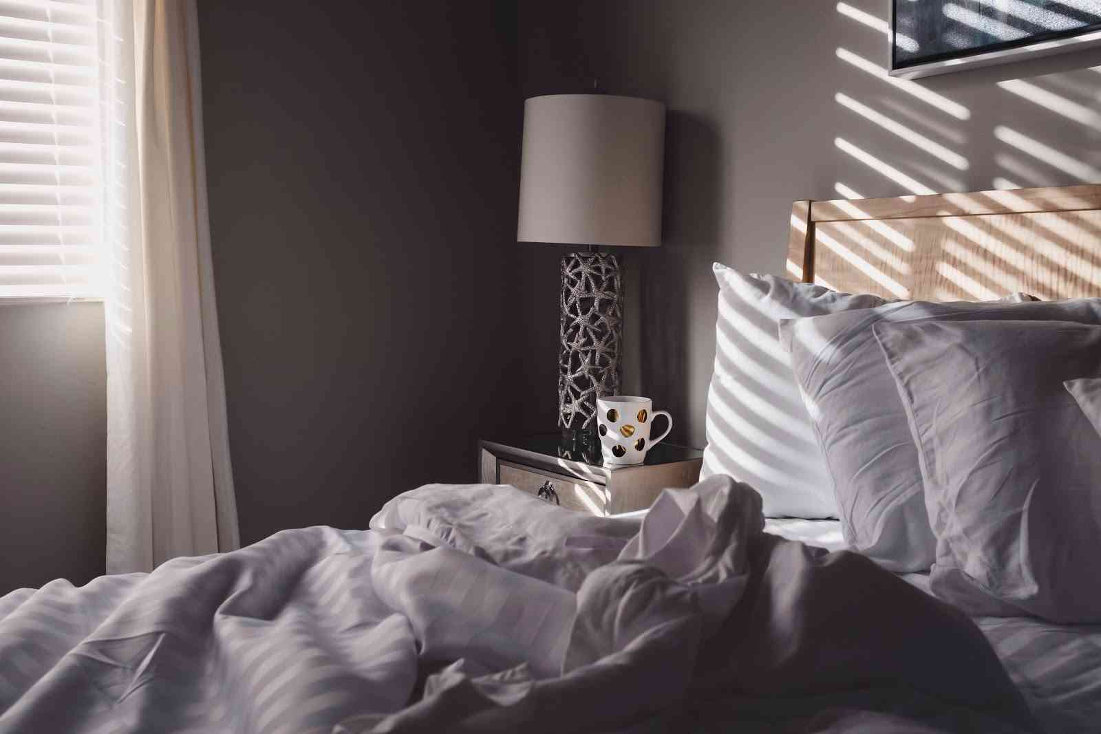 cosy grey bedroom with a dotty mug