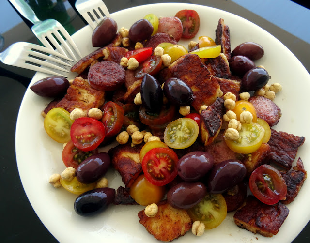 Lunch of halloumi, olives and tomatoes
