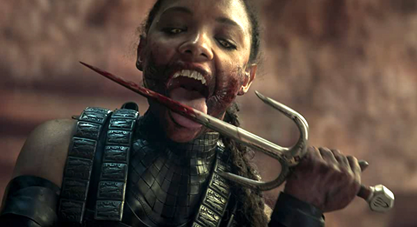 Mileena (Sisi Stringer) enjoys the taste of blood in MORTAL KOMBAT.