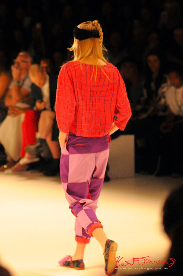 Red top with contrasting check pants, Matiny Ng's 580 fashion label at MBFWA Raffles International Showcase, Carriageworks Sydney. Photographed by Kent Johnson.