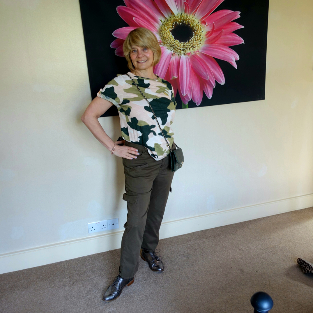 Is This Mutton blogger Gail Hanlon in khaki cargo pants and pale pink camo patterned tee shirt