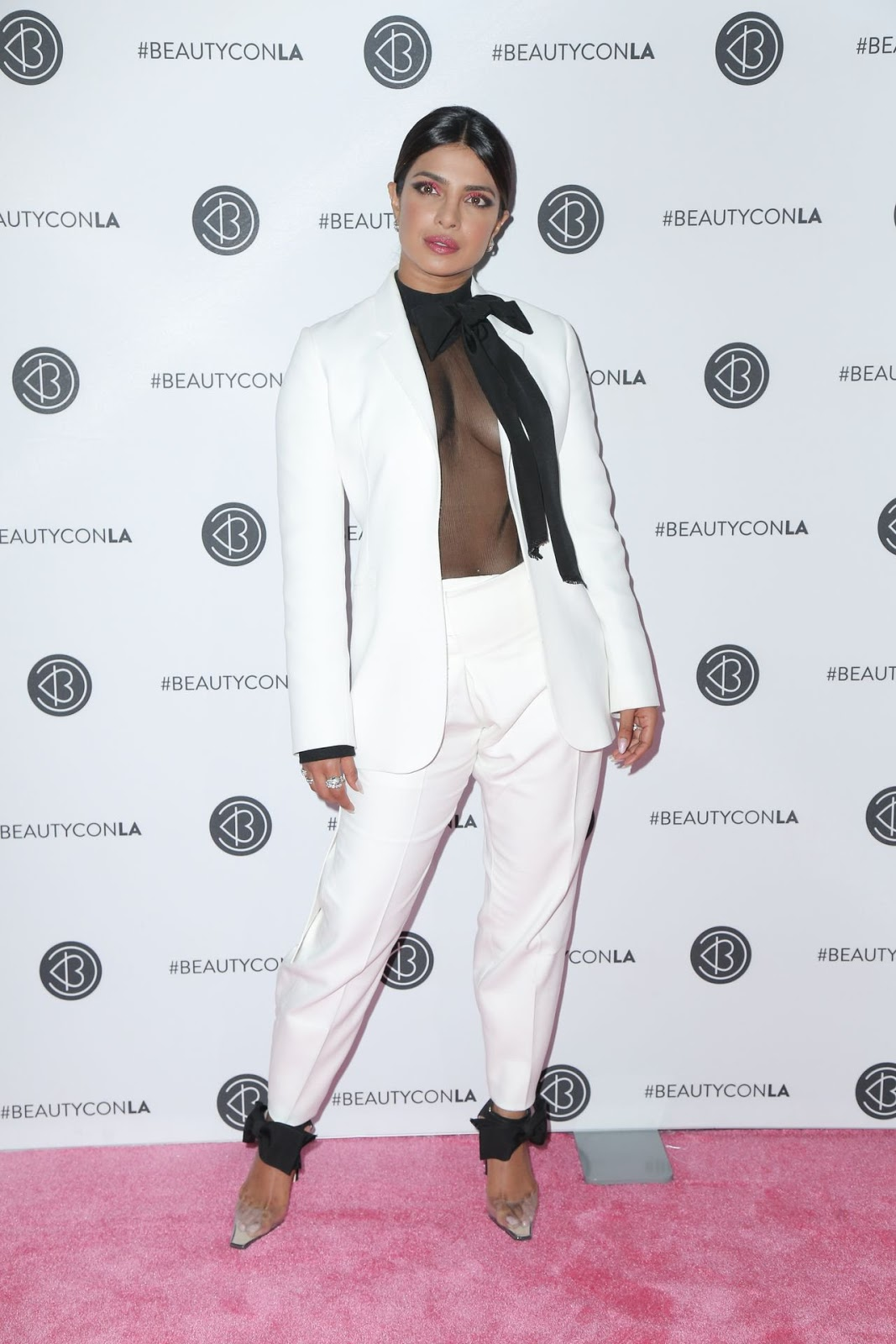 Priyanka Chopra wears racy sheer blouse under a white suit at Beautycon LA