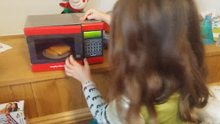 Youngest playing with microwave