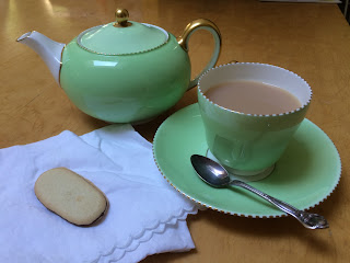 Teapot and cup in Wedgwood pale green china