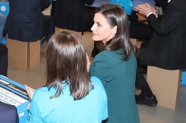 Queen Letizia wore a new suit and a silk blouse by Hugo Boss. Her shoes were by Magrit