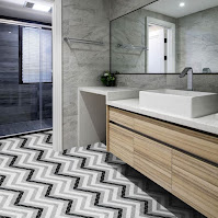 Chevron floor tiles and floating wooden vanity for unique bathroom decor ideas