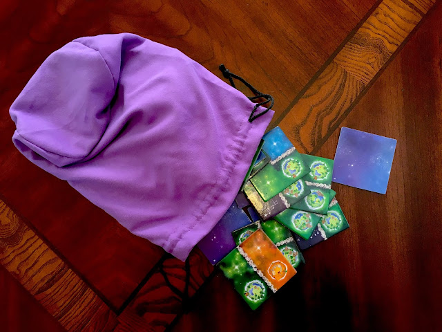 Galaxy tiles and draw bag for Kaosmos Cosmic Factory board game by Gigamic and designed by Kane Klenko