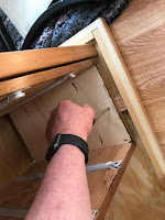 Attaching the cabinet to the strapping