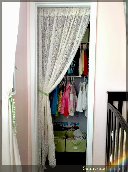 Hang a closet curtain with cup hooks and a dowel