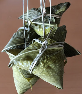 Four packages of glutinous rice wrapped in bamboo leaves known as sasamaki in Japan