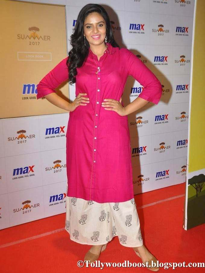 Beautiful Telugu TV Girl Srimukhi Long Hair Stills In Pink Dress