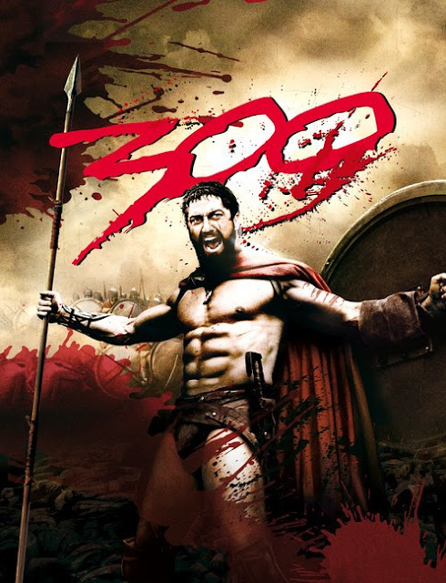 Promotional poster for movie 300 with King Leonidas raising his spear and shield in each hand triumphantly while yelling