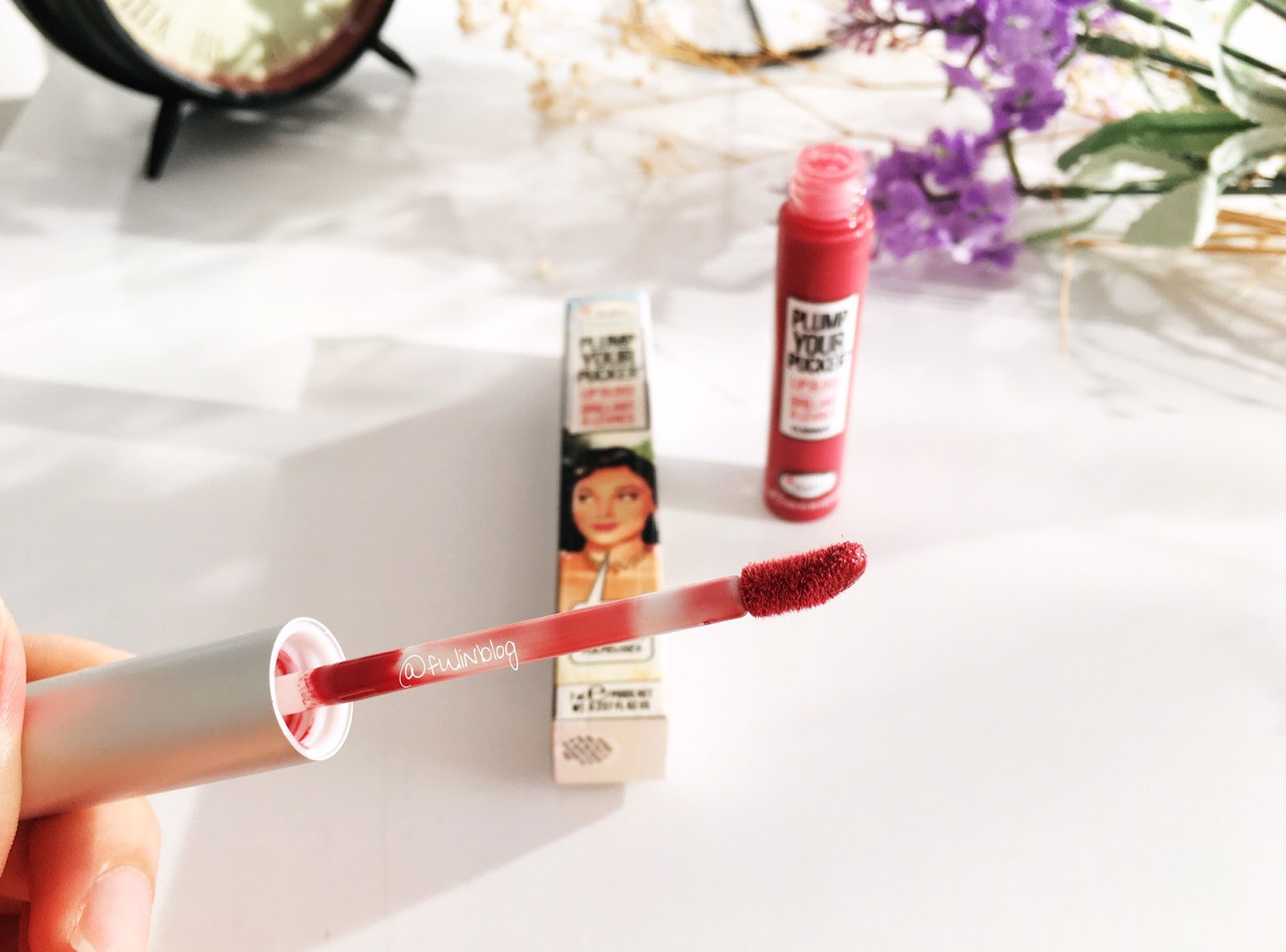 the balm plump your pocker lip gloss elaborate