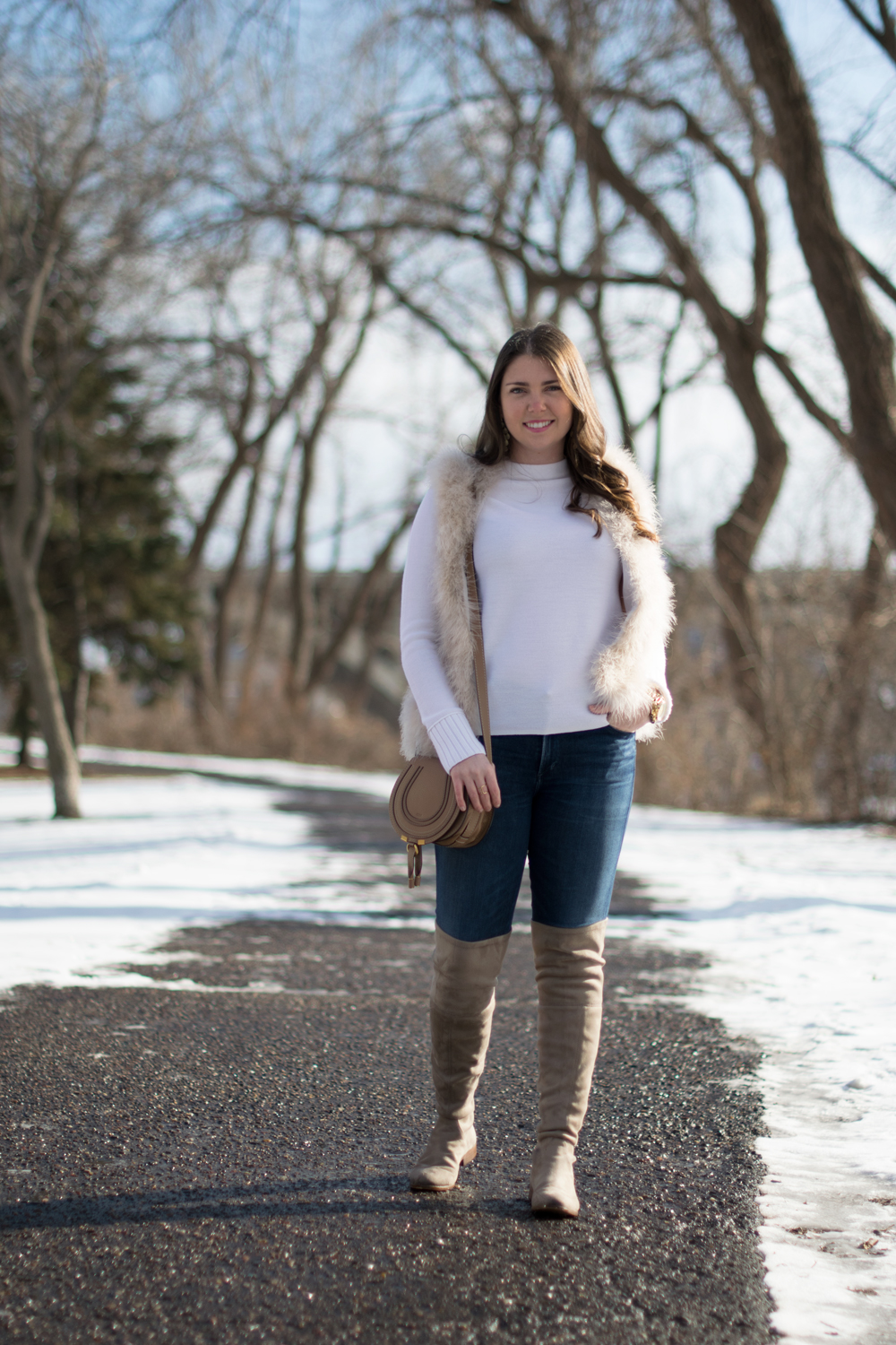 Winter white and neutral outfit on young woman.