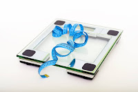 From Pexcels.com -- Blue Tape Measuring on Clear Glass Square Weighing Scale