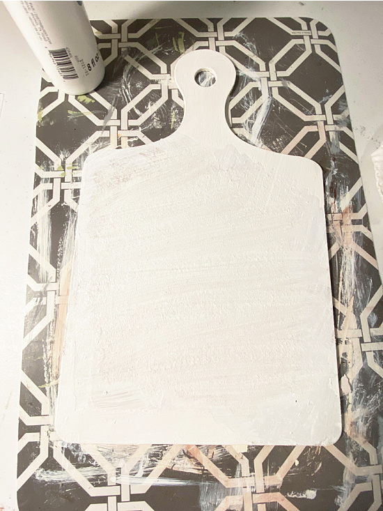 white painted cutting board sign