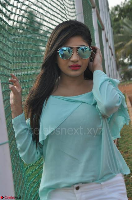 Madhulagna Das looks super cute in White Shorts and Transparent Top 06.JPG